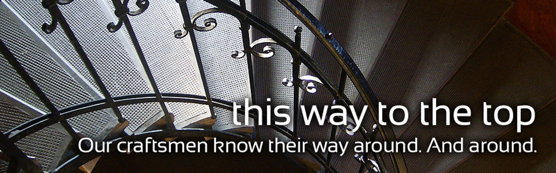 Metal Staircase Photo. The text reads, This way to the top. Our craftsmen know their way around. And around.