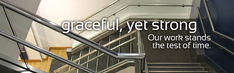 stainless steel handrails in commercial building stairwell