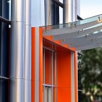 office building entry with metal and glass awning
