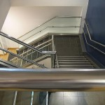 polished steel handrails in office stairway